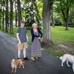 innkeepers with dogs on driveway