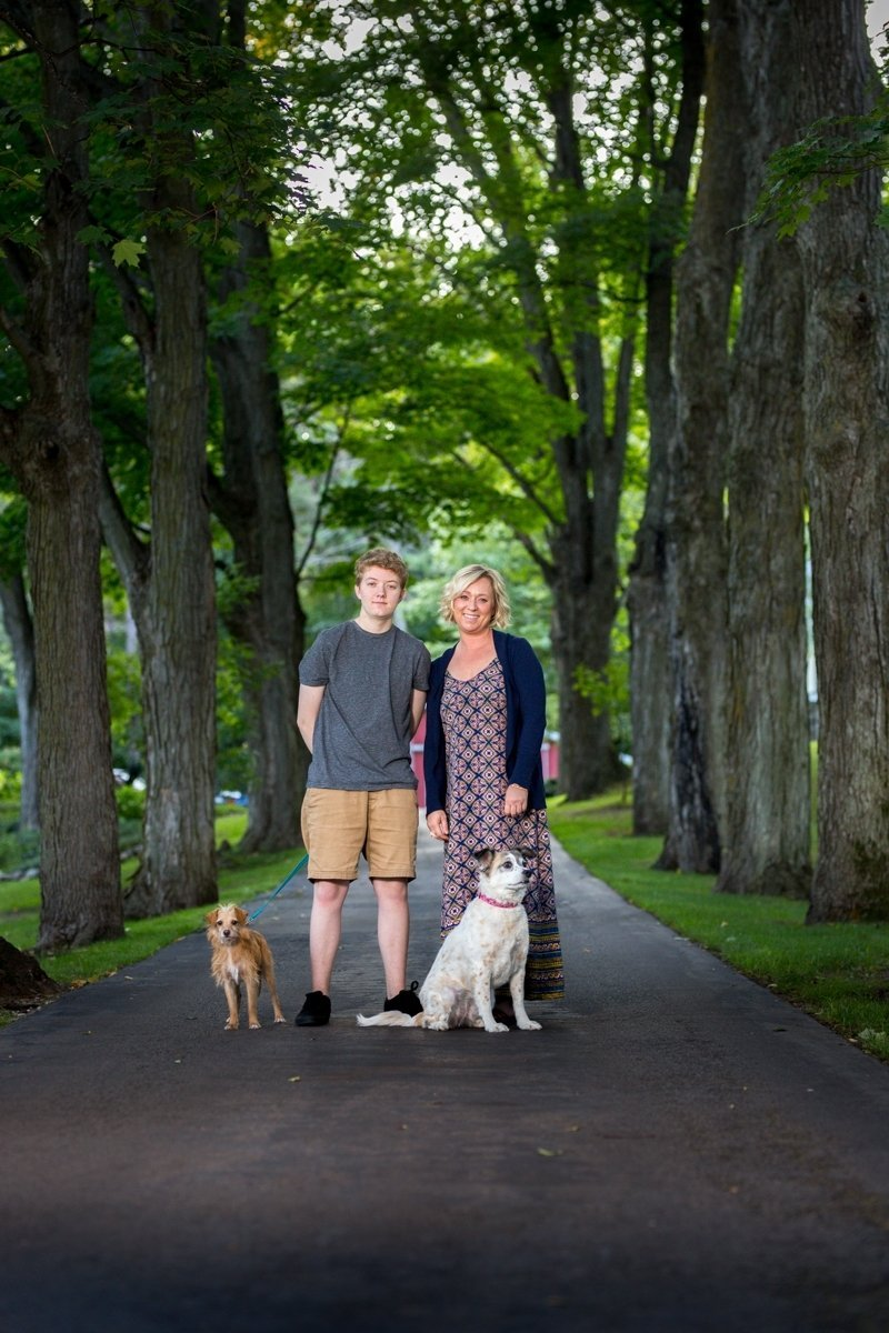 inn owner and son with dogs